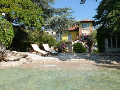Photo for lake side charming villa with its very own private beach and enclosed garden