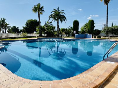 Photo for Comfortable sunny air-conditioned apartment with large terrace. Shared pool.