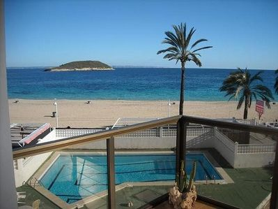View from balcony of pool and beach