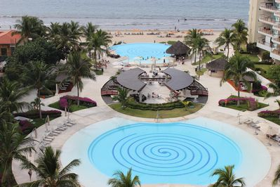Beautiful views of the pools and beach from our balcony