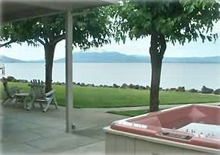 Enjoy 180 degree views of the lake while having a cup of coffee in the hot tub