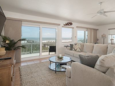 Living room has great ocean views, plenty of seating and a big screen TV and cable.