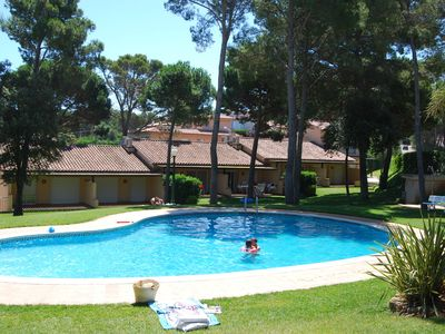 Photo for Nice bungalow with pool in a wooded area near the beach of Playa de Pals