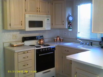 This is the kitchen it has a full size range, refrigerator & microwave pots,pans