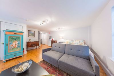 Expansive modern downtown studio wtih eclectic furnishings