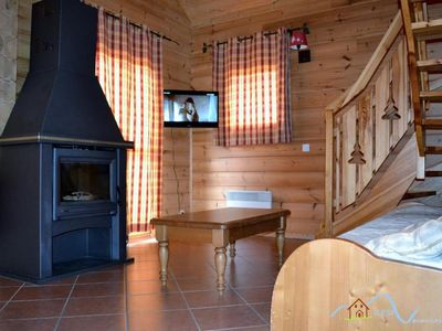 Photo for Surface area : about 115 m². Orientation : South-East, South. View mountain. Living room with stove
