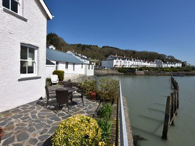 Photo for 2 Bedroom Waters Edge Cottage With Stunning Sea Views