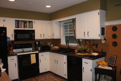 Full kitchen for all your cooking needs! Flat top oven, dish washer, fridge