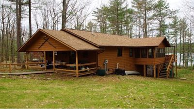 Photo for Cozy, private, woodsy retreat; clear water, sandy bottom, close to bike trails!
