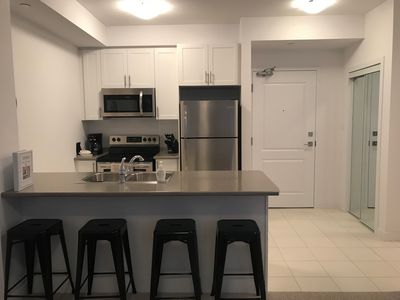 Fully equipped kitchen with brand new stainless steel appliances and double sink