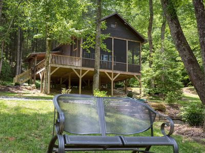 Photo for Lovely, riverfront cabin in secluded setting w/ private hot tub, deck, & firepit