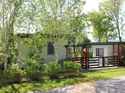 Photo for Beautiful cottage with lovely garden on a small holiday park in Goedereede