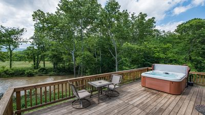 Enjoy views of the river and the mountain, while soaking in the hottub
