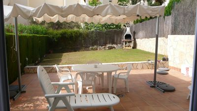 Photo for Ground floor apartment with private garden, pool, near the beach, shops, walk