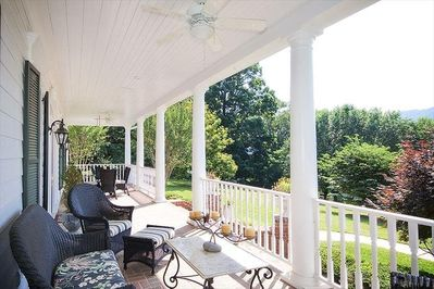 Relax on the expansive front porch... with ample seating and lovely morning sun.