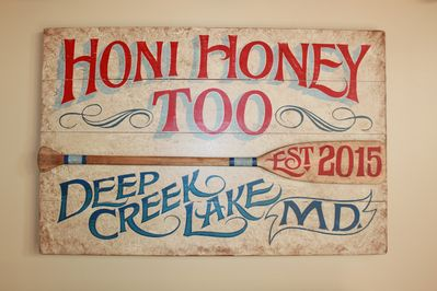 Beautiful hand painted sign commissioned by a local artist