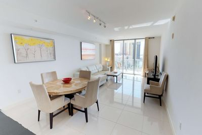 Beautiful 8th floor condo, with immaculate, contemporary design; bathed in sunlight from the floor to ceiling windows.