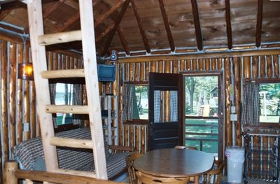 interior of front of cabin, fully equipped kitchen on right, not pictured