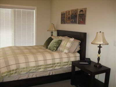 Master bedroom - queen bed and TV; looking out to canal