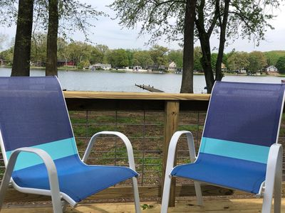 Relax at the lake shore in an updated tiny house.