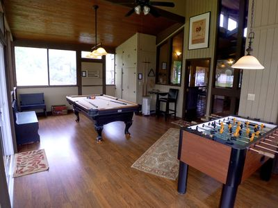 Game room with pool table and foosball table.  Outdoor ping pong.