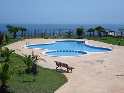 Photo for Ground Floor Apartment With Shared Pool And Fantastic Sea Views