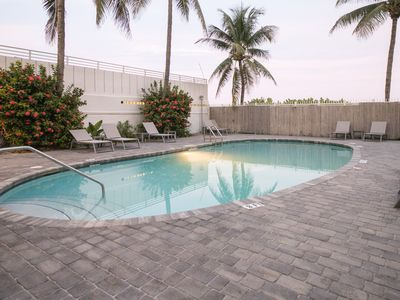 Photo for Newly renovated beachfront condo w/ pool in luxurious South of Fifth - 1 dog OK!