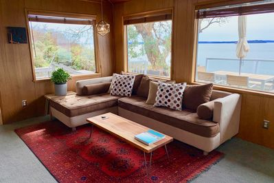 Sink into the deep sectional couch in the living room.
