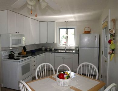 Fully equipped modern kitchen with dishwasher and full size appliances