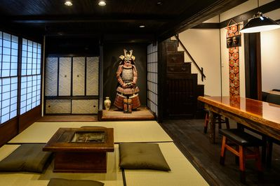 The ground floor, Japanese living space, dining room, box-stairs leading to the loft bedroom,  Western bedroom on the right, and Samurai Kevin in the takenoma (alcove)