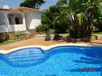 Photo for Lovely holiday bungalow with private pool, near the beach, golf and tennis courts