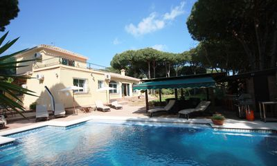 Photo for 7 bedroom Villa, sleeps 15 with Air Con, FREE WiFi and Walk to Beach & Shops