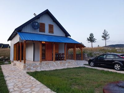 Outdoor appearance of the house  and parking space for our guests.