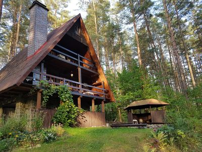 Photo for Holiday house Marianna in the forest -directly on the lake Kalwa- (with rowboat & sauna)