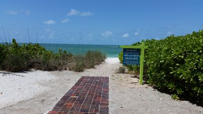Follow the paver pathway of Sea Splendor to the white  sand beach & Gulf of Mex