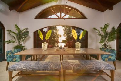 Dining area overlooking the pool, ocean and sunset.   Breathtaking.