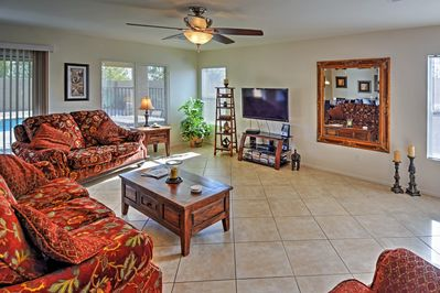 The bright and airy living room features a flat screen TV for your entertainment.