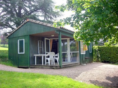 Photo for CHALET IN LAKE BORDER, GREEN PERIGORD, swimming pool, ideal calm and rest.