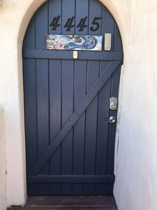Blue door with the mermaid has electronic key pad for easy entrance.