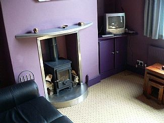 The Cosy Lounge with wood burning stove