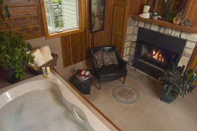 Jetted tub for two in it's own room with fireplace.