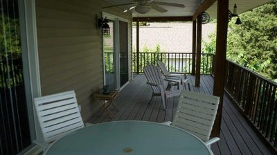 The large wrap-around covered deck can easily fit your entire group!