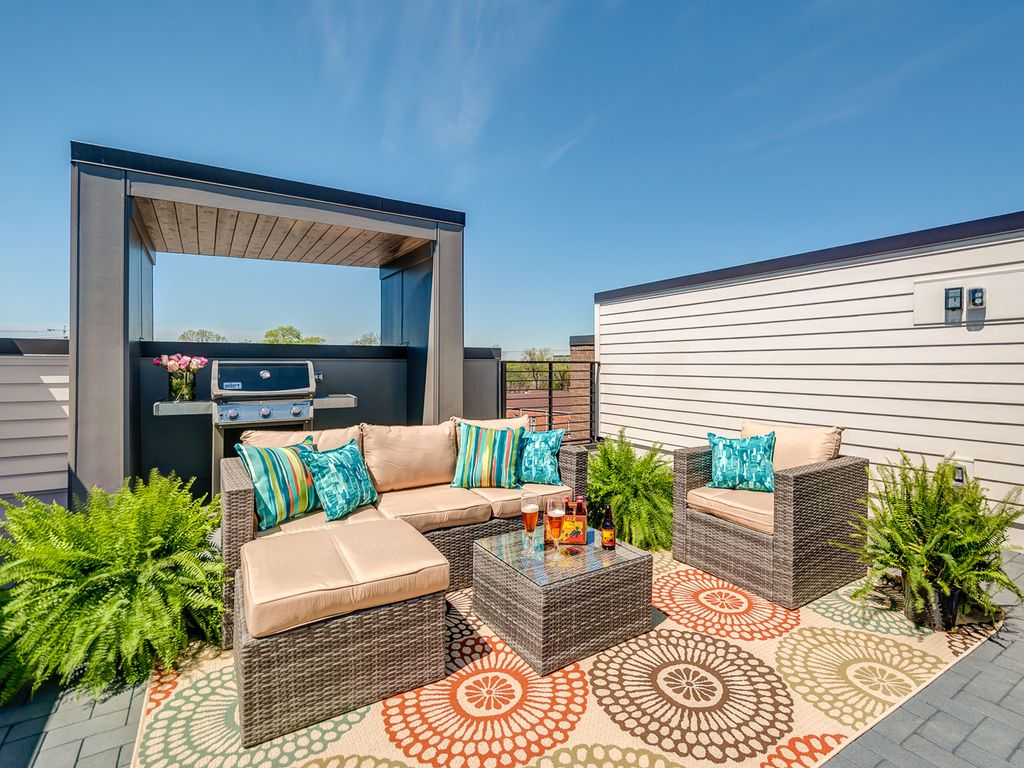 Deck   Rooftop Deck Furnished With Rattan Furniture, Potted Ferns And A  Covered Grill Area