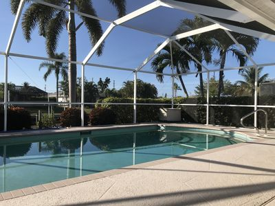 Photo for Gulf access canal home with private pool close to downtown Cape Coral