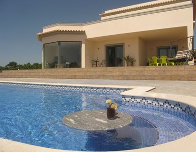 Photo for Luxurious and contemporary villa with heated pool, WiFi & Home Cinema 6879/AL