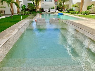 Photo for MODERN NEW 2 BEDROOMS CONDO 150 METER FROM THE BEACH