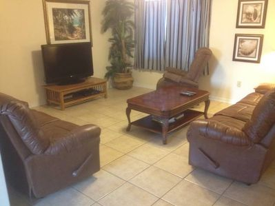 Living area with plenty of seating room and ceramic tile throughout.