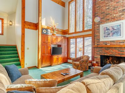 Photo for Wooded home with private sauna, full kitchen- access to clubhouse amenities!
