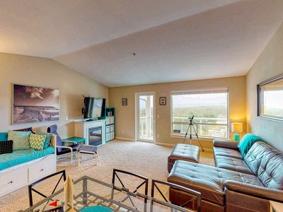 Photo for Top floor condo w/ ocean, jetty, & lighthouse views, and shared pool - dogs OK!