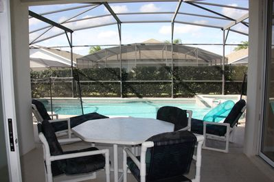 Looking from the sliding doors to the pool and spa.  Enjoy dinner outside!